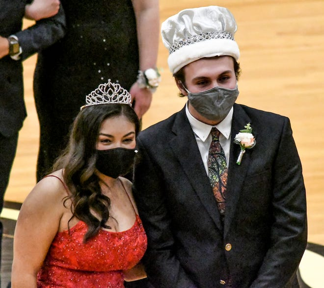 Jasmin Flores, left, and Ryan Wessels are the new winter sports homecoming queen and king, respectively, at Garden City High School. The pair were crowned Friday durng a halftme ceremoy at the boys' basketball game.