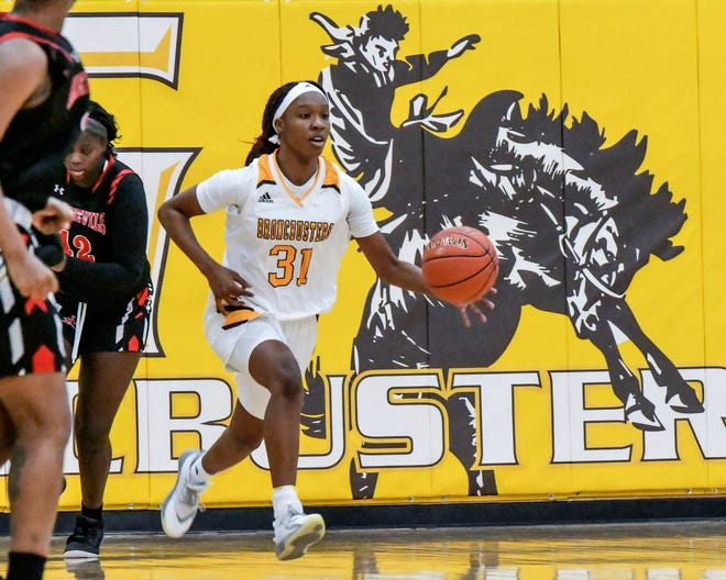 Garden City Community College's Donetria McGee starts a fast break for the Broncbusters Saturday against Allen County at Perryman Athletic Complex.