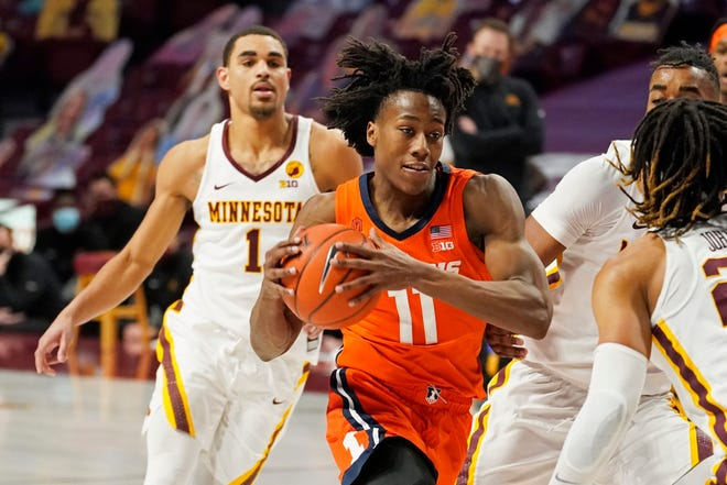 Illinois' Ayo Dosunmu (11) drives past Minnesota's Tre' Williams (1) in the second half of a game on Saturday, in Minneapolis. Dosunmu scored 19 points.