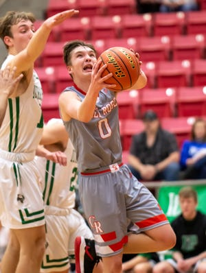 Glen Rose's Matthew Hammonds drives to the hoop for two of his 22 points in the Tigers' 54-50 playoff win over Iowa Park on Saturday night at Mineral Wells High School.