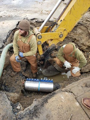 Crews with the city of Denison work to repair a water line that was damaged during winter storms in February. The date, the city has submitted nearly $900,000 of expenses related to the storms to FEMA for reimbursement.
