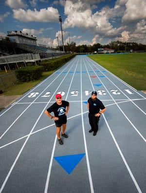 Lake Region track coaches Doc Honer, left, and John Blackburn Jr. stand on the newly resurfaced Lake Region High School track.