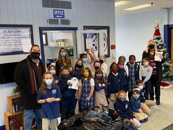 CEO Lori Richardson and Chief Marketing Officer David Ginisi visited Mrs. Lawson's third-grade students at St. Anna's Catholic School, where they were presented with more than 900 pairs of socks for the aging community of North Central Massachusetts.
