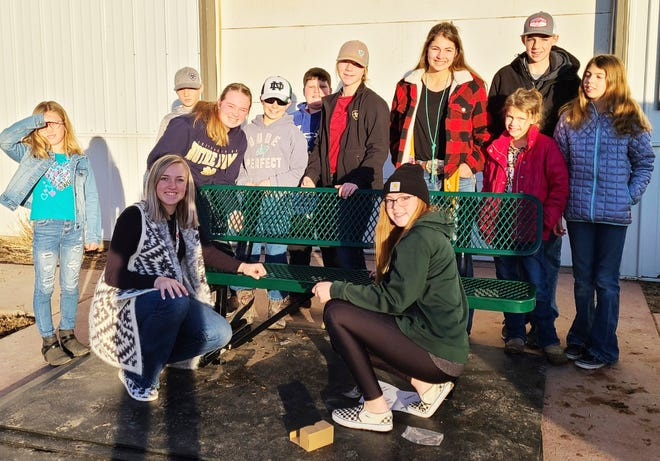Members of the Cloverleaf Livestock 4-H Club of Fowler met in January to assemble a bench being donated as a community service project. Back row, from left, Emma Pharr, Garrett Pharr, Katie Nesselhuff, Nate Nesselhuff, Joshua Larson, Izzy Pharr, Jenna Day, Ryan Day, Riley Day and Kacie Day. Front row, Kaley Pieper and Korey Pieper.