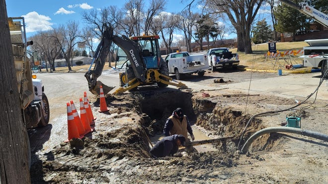 """La Junta street crews braved the brisk Saturday and Sunday air to repair up to four breaks that occurred along about a 20-25 inch section of water main pipe on Colorado Ave. next to Otero Junior College. City Engineer Tom Seaba said he and his crews were thankful the breaks occurred last weekend as opposed to two weeks ago during the """"exceptionally cold"""" weather."""
