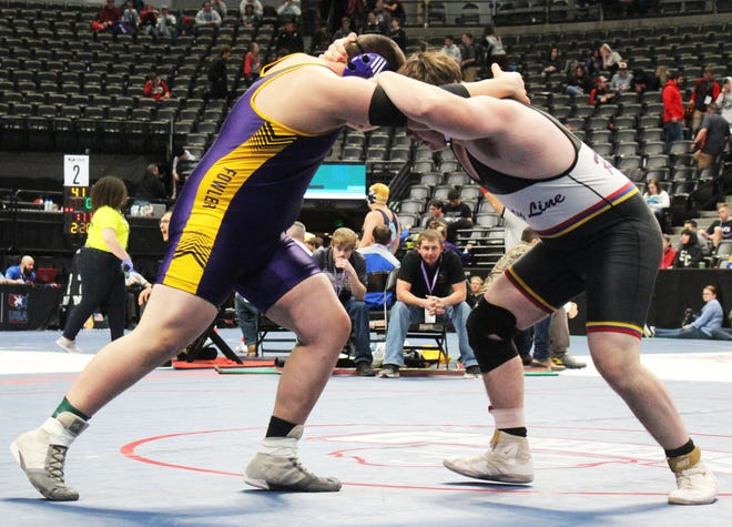 J.J. Horn (left) of the Fowler High School wrestling team squares off with County Line's Taite Johnson at the Class 2A State Tournament last season.