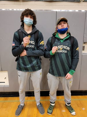 Shown are Basehor-Linwood wrestlers Connor McMillen and Tanner Parrish. Both advanced to the state tournament Saturday with top-4 finishes in their respective weight classes.