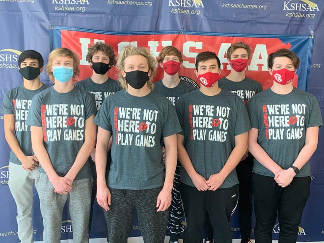 Shown is the Lansing men's swimming team at the 5A state swimming meet Saturday at the Shawnee Mission School District Aquatic Center in Lenexa.
