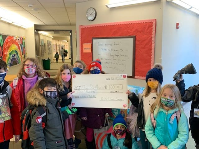 Maille McAlpin's classmates at the Harley School donate $100 from their recent Harlic Garlic sale to help provide clothing essentials and resources for area residents in need.