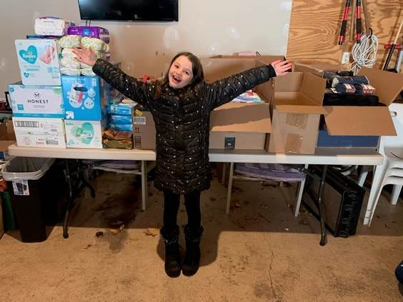Harley School third grader Maille McAlpin holds a sock and underwear drive for the Open Door Mission and Rochester Area Interfaith Hospitality Network. Her efforts collected $1,700 and multiple boxes filled with socks, underwear, clothing, diapers and baby wipes.