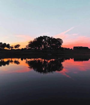The sun sets behind a beautiful lake at Pickleball Paradise TX, which will be opening soon in Midlothian.