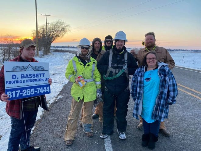 Midlothian residents Shannan Teubner (front, right) and Sammy Davidson (back, right) pose with linemen who helped restore electricity after last week's historic winter storm. Teubner runs Shannan's Kitchen, which provided home-cooked meals to about 60 linemen.