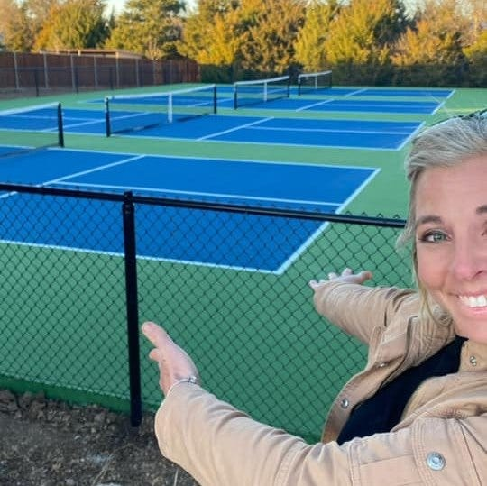 Midlothian resident Michelle Cornish shows off her new courts at Pickleball Paradise TX, which will be opening soon.