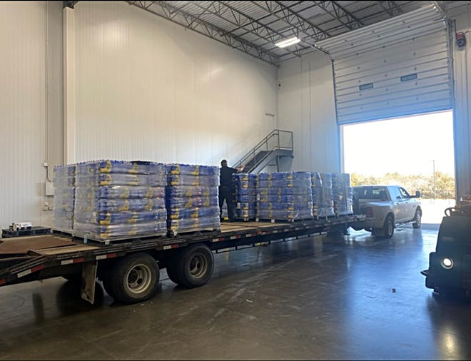 Pallets of bottled drinking water arrive at the former Midlothian Fire Station No. 1 on Monday. Water will be available for pickup to residents who do not have running water through Friday evening.
