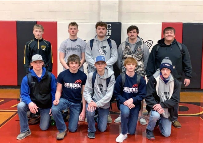 Moberly High School wrestlers that participated in the Class 2 District 7 tournament held Feb. 13 at Chillicothe are freshmen Gage St. Clair and Carter Smith, sophomore Hunter Boots, freshman Nick Kessler and Tyler James. Second row are freshman Austen James, junior Dakotah Courtney, senior Jarrett Kinder, junior Beau Garrett and senior Andrew Huff. The following Spartans qualified for the Sectional 4 event being held Feb. 27 at Excelsior Springs H.S.; Kessler at 106 pounds,  Austen James at 120, Boots at 126, St. Clair ot 138, Courtney at 152, Garrett at 195, Kinder at 220 and Huff at 285.
