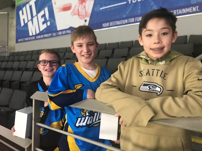Ethan, Brayden and Joshua Parshall (left to right) of Temperance attend a Toledo Walleye game last season. The family loves going to games, but have not been able to this winter because the team decided not to play its ECHL schedule because of COVID-19.  [Courtesy photo]