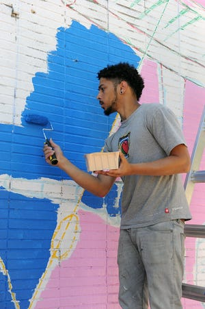 Yotron The Don works on Marval's Musical Mural in Framingham in 2018. Marlborough City Councilor Samantha Perlman is seeking an ordinance to bring murals to Marlborough.