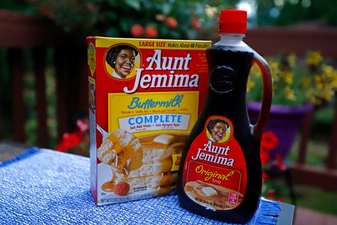 A box of Aunt Jemima Buttermilk Pancake and Waffle Mix and a bottle of Aunt Jemima Original Syrup.