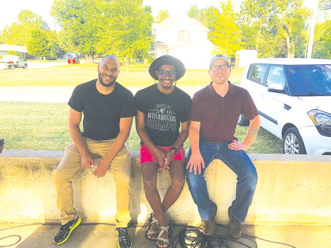 Haviland residents (from left) Ethan Chance, Marcus Collick and Aaron Stokes (Mayor of Haviland) spoke at a rally last summer about racism in small towns.