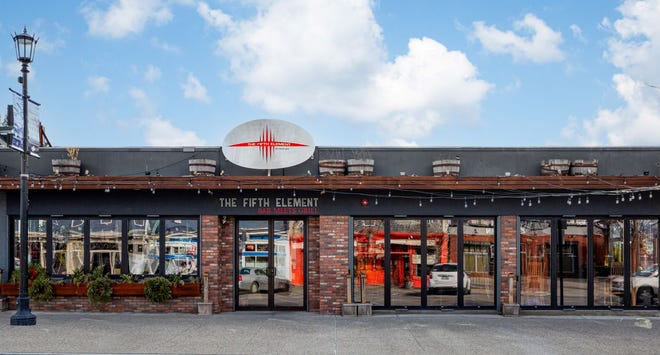 Newport's Fifth Element restaurant and adjacent property are for sale.