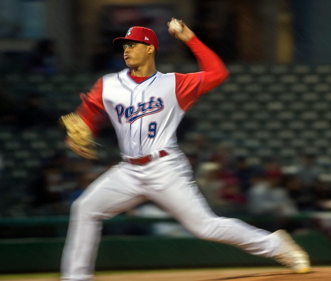 Stockton Ports' Jesus Luzardo delivers a pitch  on the Ports' opening day against the Lake Elsinore Storm at the Stockton Ballpark in downtown Stockton. The background as well as the pitcher's extremities are blurred but his face is sharp due to a panning technique.