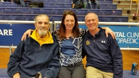 Kent State legend Rudy Bachna, left, with former Kent State gymnast Shannon (Gallagher) Simmons and current KSU coach Brice Biggin.
