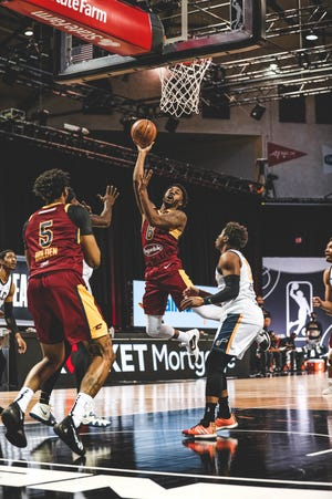 Charge guard Levi Randolph scores two of his 29 points against the Salt Lake City Stars, Sunday, Feb. 21, 2021 at HP Field House in Orlando.