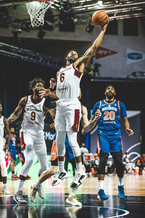 The Charge's Levi Randolph (6) grabs a rebound against the Westchester Knicks during an NBA G League game on Feb. 22, 2021 at HP Field House in Orlando, Florida.
