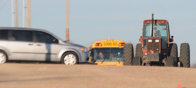 Cadden Isaacson, 16, drives his families 5488 International tractor to school as he pulls into the entrance of Southeast of Saline during drive your tractor to school day that was part of FFA week on Monday.