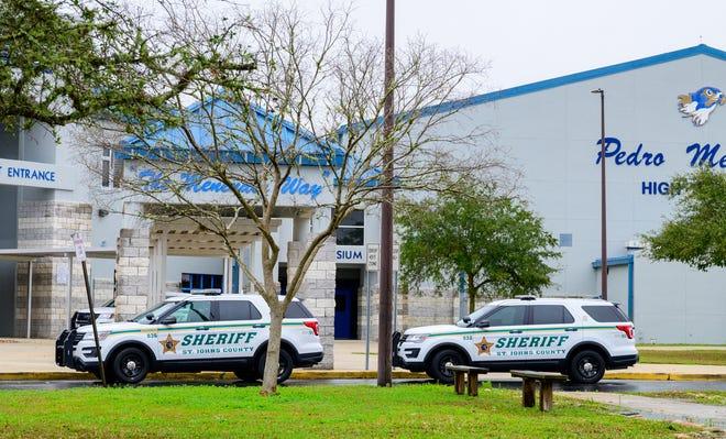 St. Johns County Sheriff's Office patrol cars sit outside of Pedro Menendez High School on Friday, Feb. 19, 2021.