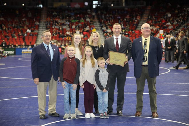 Roland-Story Athletic Director Brian Petersen, pictured with his family, received the 2021 Iowa Athletic Director of the Year Award prior to the start of the state wrestling finals Saturday at Wells Fargo Arena in Des Moines.