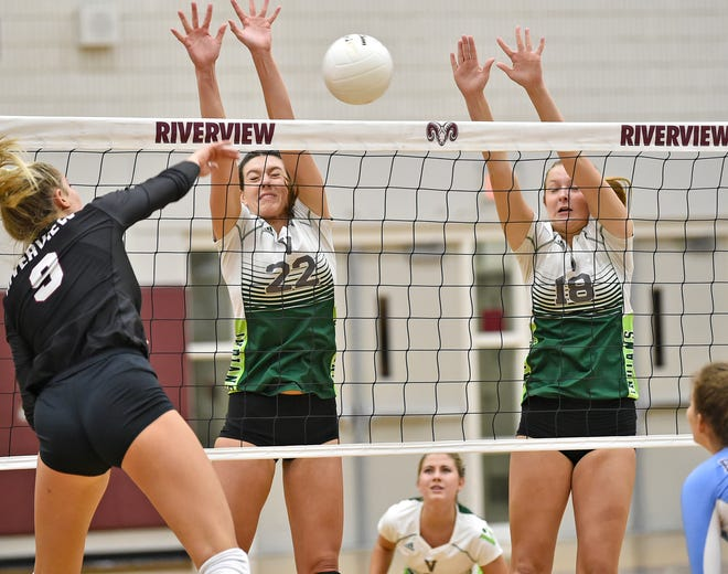 Riverview High junior McKenna Flaherty, left, shown here spiking the ball against Venice High, had 255 digs, 234 kills, 22 blocks and 18 aces for the Rams.