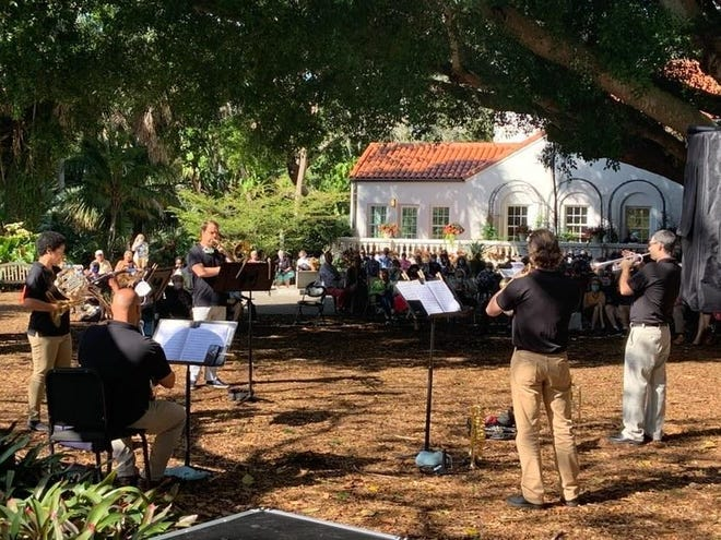 A Sarasota Orchestra brass ensemble performs outdoors at Selby Gardens. The open air makes it safer for brass and wind musicians to play.