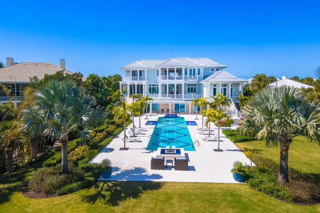 This Casey Key Gulf-to-Bay property sits on 3.5 acres with 9,600 square feet of living space and a separate guest house. It is on the market for what would be a sales record of $19.9 million.