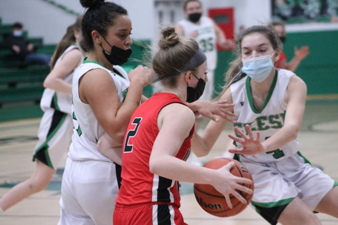 Wethersfield's Jasira Stevenson (15) and Raqi Young (4) apply defensive pressure against United ballhandler Luci Kane (2) on Friday.