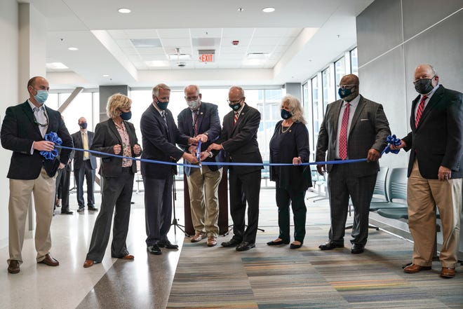 Local officials cut the ribbon to celebrate the grand opening of the new Division of Juvenile Justice building located at 138 N. Fourth Street on Monday.