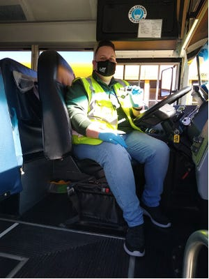 Driver Ed Eiting dons his new professional gear as he readies for his route. [CONTRIBUTED PHOTO]