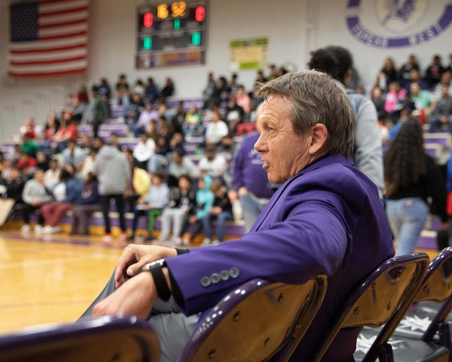 Topeka West boys basketball coach Rick Bloomquist watched his team capture the outright Centennial League title Saturday with a win over Topeka High. After the game, he informed his team that he's been diagnosed with cancer.