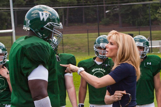 "Quint Aaron and Sandra Bullock in a scene from, ""The Blind Side."""
