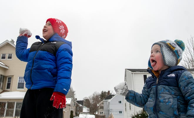 Thomas Coyle, 5, left, and his brother Jacob, 2, had fun in the snow Monday. Thomas was on recess from remote schooling. The boys were playing with their grandmother Karen Coyle, a teacher who was on her own recess.