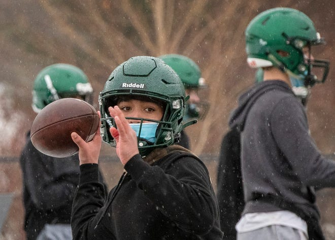 Jake Mayerhauser throws to a Grafton High teammate on the first day of football practice of the fall II season at Richard Egsegian Memorial Athletic Field on Monday.