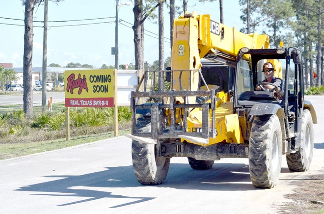 Work crews were busy Monday building Rudy's Country Store and Bar-B-Q in Panama City Beach.