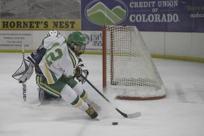 Pueblo County High School senior hockey player Luke Guarienti is trying to get through a difficult season with the Hornets. [Chieftain file photo]