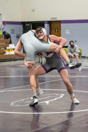 Rye High School's Remington Peterson shoots in for a double leg takedown on Manitou's Rylan Dowling during their 195-pound match at the Rye quad on Friday February 19, 2021.