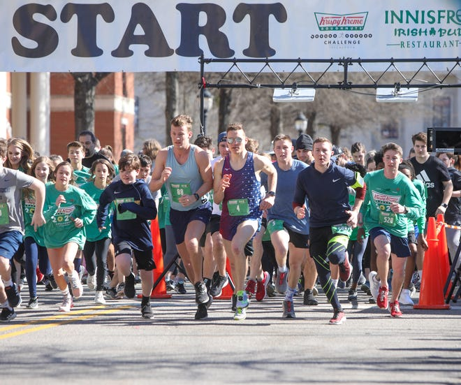 Runners dash away from the start line of the Krispy Kreme Challenge Saturday, Feb. 29, 2020 at Government Plaza. [Photo/Joe Will Field]