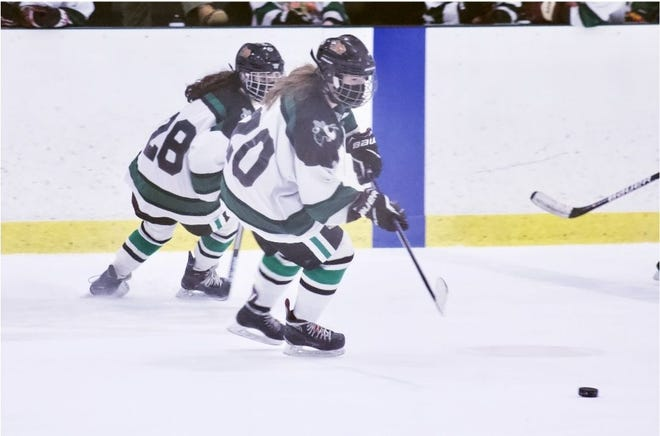 MOA Warriors Cierra Doherty (20) and Lily O'Brien (28) on the attack during a Feb. 19 game against King Philip.