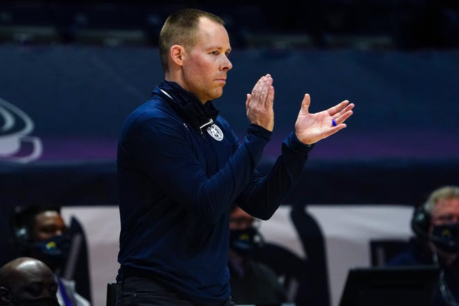 Xavier Musketeers head coach Travis Steele encourages the team in the second half of an NCAA men's college basketball game against the Butler Bulldogs, Saturday, Feb. 20, 2021, at Cintas Center in Cincinnati. The Xavier Musketeers won, 63-51.