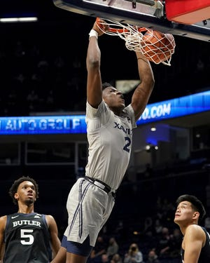 Xavier Musketeers forward Danny Ramsey (2) dunks in the first half of an NCAA men's college basketball game against the Butler Bulldogs, Sunday, Feb. 21, 2021, at Cintas Center in Cincinnati.