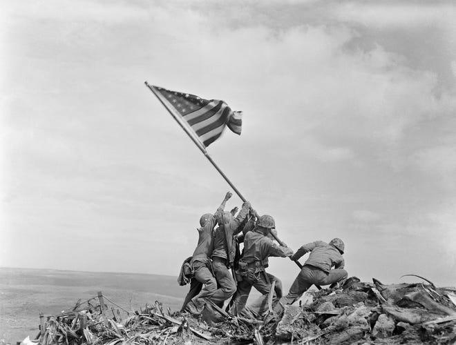 U.S. Marines raise the American flag on Iwo Jima on Feb. 23, 1945 in this iconic photo from World War II.