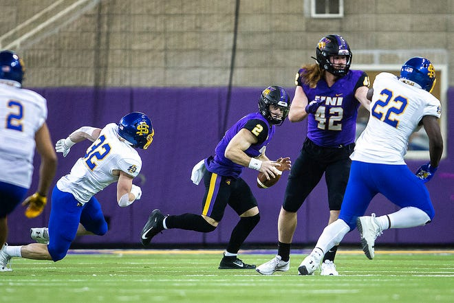 South Dakota State linebacker Adam Bock (32) closes in on Northern Iowa quarterback Will McElvain (2) during a NCAA college Missouri Valley Football Conference game, Friday, Feb. 19, 2021, at the UNI-Dome in Cedar Falls, Iowa.